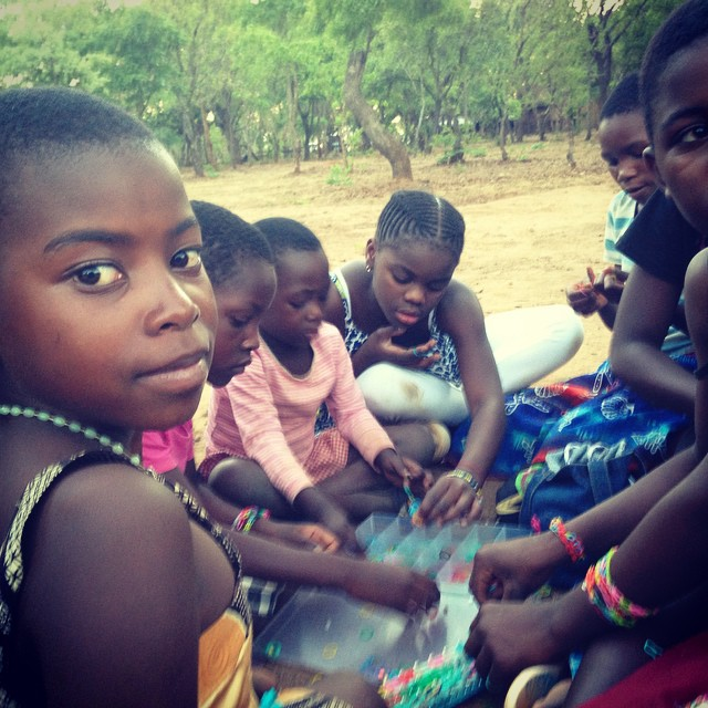 Mercy shares her bracelet looms with her new friends. #raisingmalawi #livingforlove